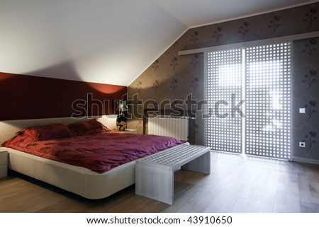 Interior Of New Bedroom In Daylight With Big Window Sto