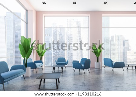 Interior of office lounge with concrete floor, blue couches, neat coffee table and large potted plants near panoramic cityscape windows. 3d rendering