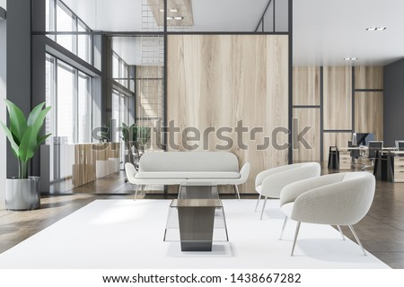 Interior of office waiting room with gray and wooden walls, comfortable armchairs and sofa near coffee tables and open space area in background. 3d rendering