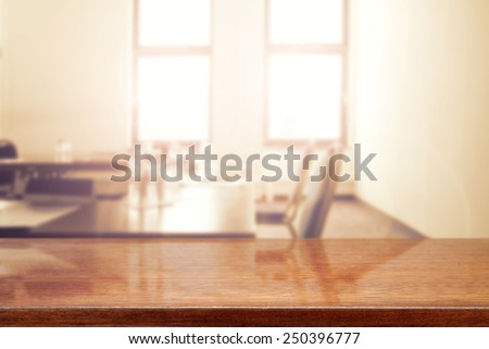 interior of office with window and table with chair and brown desk