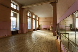 interior of old abandoned Gym for ballet training. An old abandoned ballet studio, an impostor class. abandoned gym of Soviet building of times USSR. interior of an old abandoned building. Ballet room