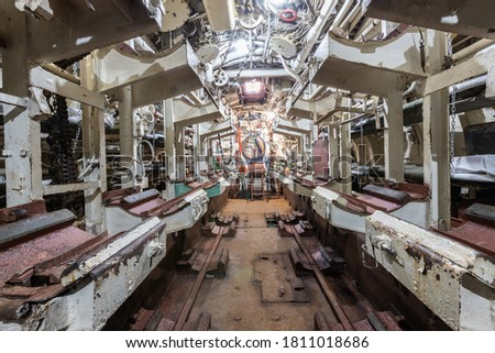 Photo of  Interior of old abandoned Russian Soviet submarine. Interior of combat submarine