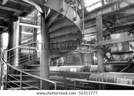 Interior of old factory with metal circle stair.