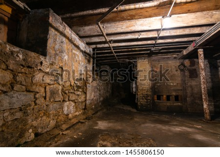 Interior of old grungy warehouse basement. Foto stock ©
