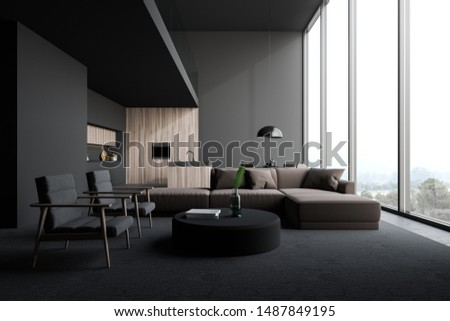 Interior of open plan room with living room area with beige sofa and armchairs near round coffee table and kitchen with gray and dark wooden walls, island, countertops and table. 3d rendering