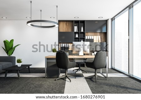 Interior of panoramic CEO office with white walls, carpeted floor, computer table with chairs for visitors, bookcase with folders and lounge area with grey sofa. 3d rendering