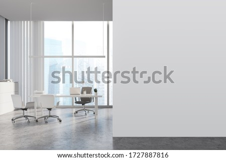 Interior of panoramic CEO office with white walls, concrete floor, white computer table with chairs for visitors and window with blurry cityscape. Mock up wall to the left. 3d rendering