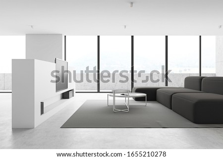 Interior of panoramic luxury living room with white walls, concrete floor, comfortable grey sofa, two round coffee tables and flat screen TV. Balcony with nice blurry scenery. 3d rendering