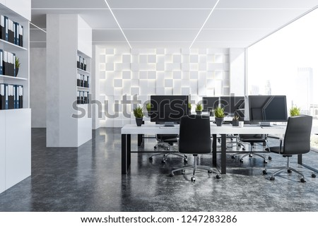 Interior of panoramic office with white walls, concrete floor, rows of white computer tables with black chairs and two bookcases with folders near the wall. 3d rendering