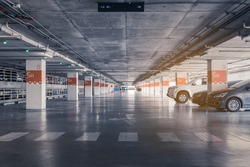 interior of parking garage with car and vacant parking lot in parking building, vintage style process