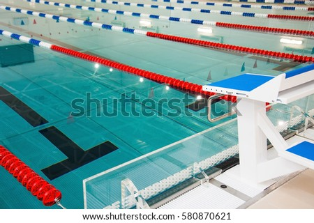Interior of public swimming pool. Lanes of a competition swimming pool #580870621
