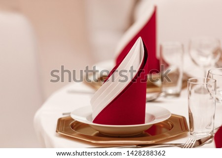 Interior of restaurant for wedding dinner, ready for guests. Decorated with napkins. napkins in the interior