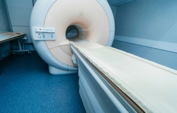 Interior of room with MRI machine.