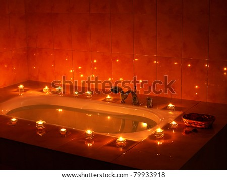 Interior of sauna tub with candle.