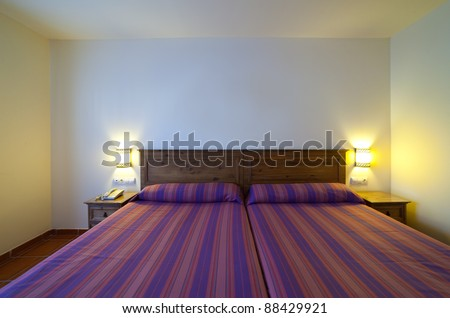 interior of  simple bedroom with two   bed