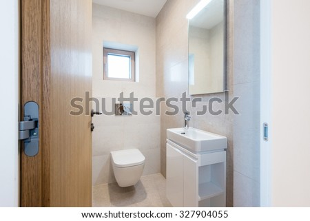 interior of small bathroom in modern house #327904055