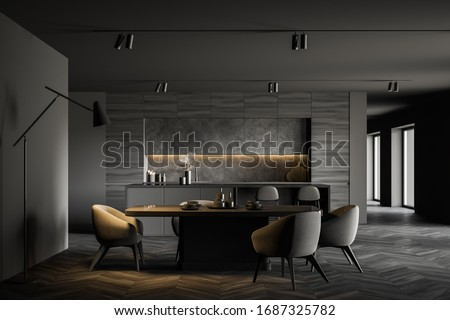 Interior of spacious kitchen with grey walls, dark wooden floor, comfortable dining table with soft armchairs, bar with stools and wooden countertops in background. 3d rendering