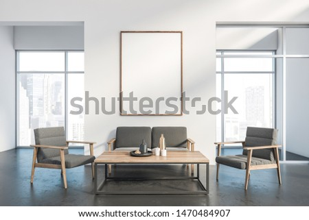 Interior of spacious living room with white walls, concrete floor, gray armchairs and sofa near wooden coffee table and windows with cityscape. Vertical mock up poster frame. 3d rendering