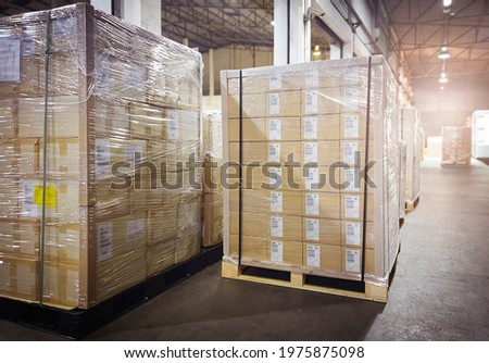 Interior of Storage Warehouse. Stacked of Package Boxes Wrapped Plastic Flim on pallet rack. L-Shape Pallet Corrugated Paper Cardboard Angle Corner Edge Protector. Shipping Warehouse Logistics. Stock fotó ©