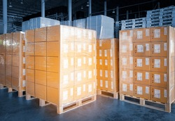 Interior of storage warehouse. Stacked of package boxes wrapped plastic on pallet rack. L-shape pallet corrugated paper cardboard Angle corner edge protector. shipping warehouse logistics.