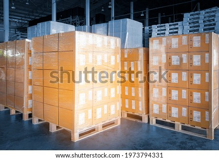 Interior of storage warehouse. Stacked of package boxes wrapped plastic on pallet rack. L-shape pallet corrugated paper cardboard Angle corner edge protector. shipping warehouse logistics. Stock fotó ©