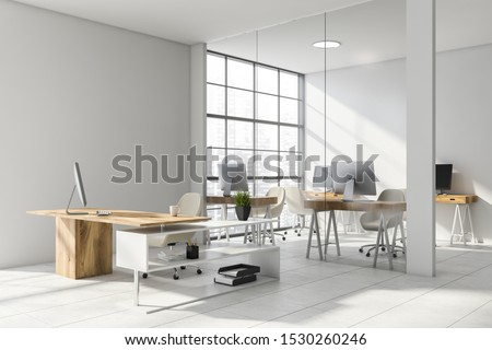 Interior of stylish CEO office with white and glass walls, tiled floor, comfortable desk and open space area with compact computer tables in background. 3d rendering