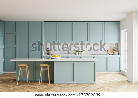 Interior of stylish kitchen with white and brick walls, wooden floor, blue countertops and cupboards and bar with stools. 3d rendering
