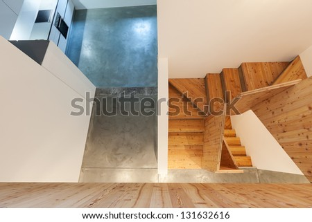 Interior of stylish modern house, wooden stairs, top view