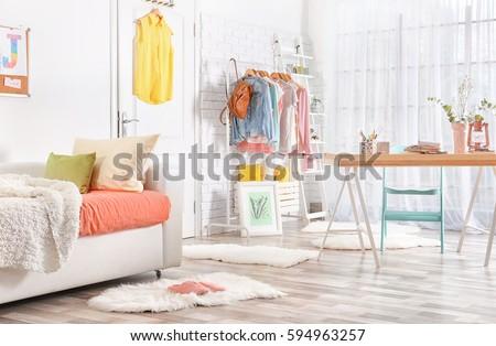 Interior of teenage girl's room with sofa