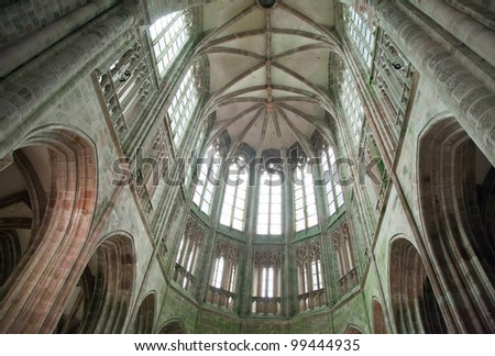 interior of the abbey Mount Saint-Michel Abbey on a rocky tidal island off the north coast of France in the Manche department. Famous landmark of France and listed in the Unesco World Heritage site #99444935
