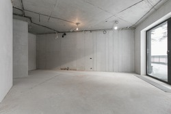 interior of the apartment without decoration in gray colors. rough finish