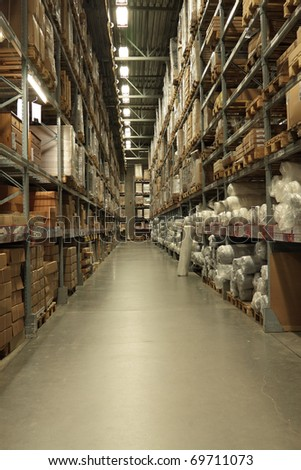 Interior of the big warehouse with the various goods