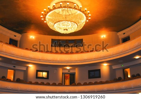 interior of the empty theater theater theater light. chairs in an empty hall #1306919260