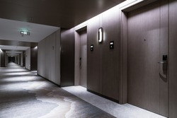 Interior of the Hotel corridor, with wood-paneled walls and elegant carpets