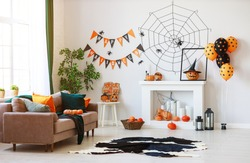 interior of the house decorated for Halloween pumpkins, webs and spiders