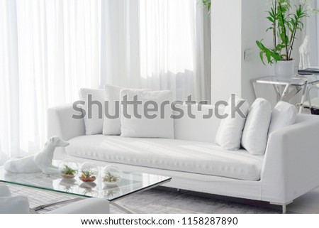 Interior of the living room of the hotel. Beautiful living room with white sofa. White Concept Living Room Interior. Modern bed room interior in Luxury villa. White colours, big window #1158287890