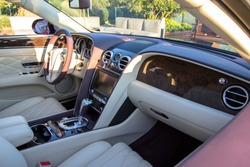Interior of the Luxury car in a light and white colours