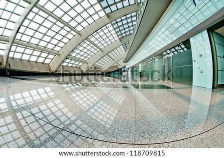 interior of the modern mall of beijin airport subway station.