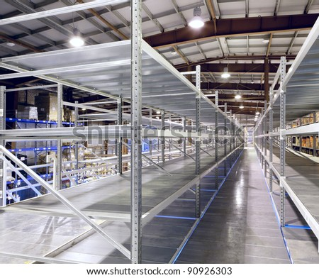 Interior of the new and modern warehouse space in a well lit large room