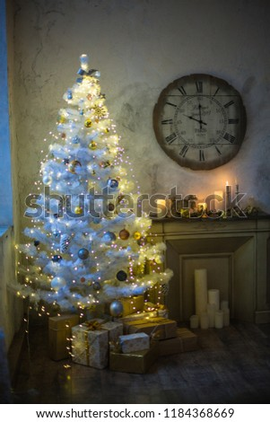Interior of the new year. White Christmas tree, fireplace, chair and clock. New Year's morning #1184368669
