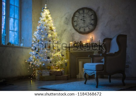 Interior of the new year. White Christmas tree, fireplace, chair and clock. New Year's morning #1184368672