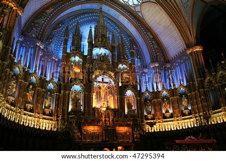 Interior of the Notre-Dame Basilica (Basilique Notre-Dame) in Montreal, Canada with deep blue ceiling with golden stars and sanctuary in polychrome of blues, azures, reds, purples, silver, and gold