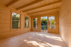Interior of timber log cabin studio constructed in back garden