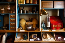 Interior of vintage grocery store with retro goods on the shelves, the Netherlands