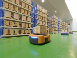 Interior of warehouse in logistic center with Automated guided vehicle Is a delivery vehicle