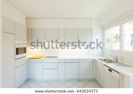 Interior of white kitchen with nobody inside.  #643024375