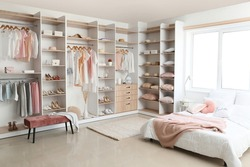 Interior of white modern bedroom with wardrobe
