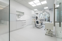 Interior of white modern dentistry medical room with special equipment