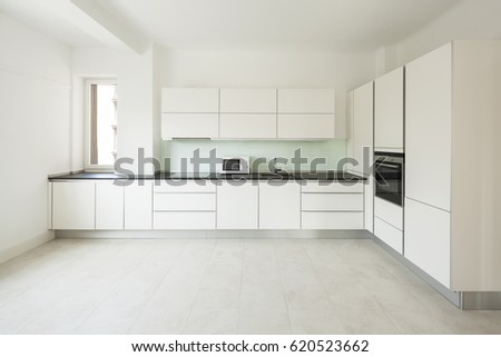 Interior of white modern kitchen, nobody inside