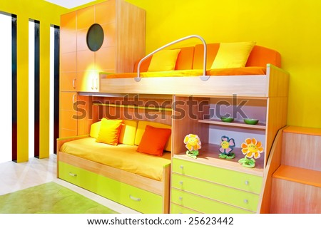 Interior of yellow kids room with bunk beds